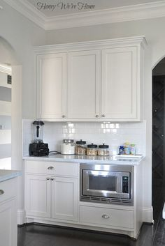 Kitchen wall color is Accessible Beige from Sherwin Williams. Creamy light greige.  Honey We're Home: Paint Colors in Our Home