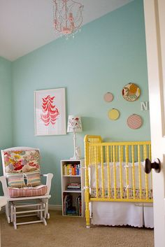 Primary inspiration for a girl's room. Love the aqua, yellow and bits of pink.