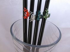 Reusable straws with cute little frogs.  Blown glass straws from Many Mini's Etsy shop.
