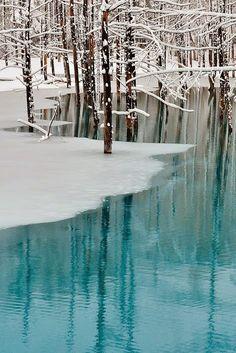 Blue pond & spring snow - Hokkaido, Japan
