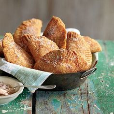 Fried Apple Pies | There's enough filling to make a second batch of these delicious pies, or you can freeze it for later. Serve warm or at room temperature. | SouthernLiving.com