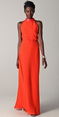 sleeveless gown with leather detail + glowing skin