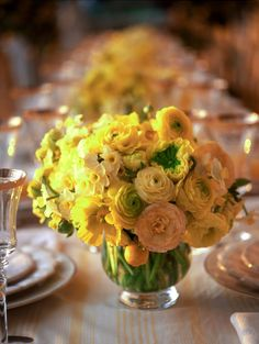 Elegant Citrus Decor.  Yellow,  ranunculus.  Photo by Meg Smith, flower design by Ariella Chezar.