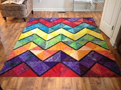 Color Inside the Lines. Lovely Chevron quilt made from bright batiks