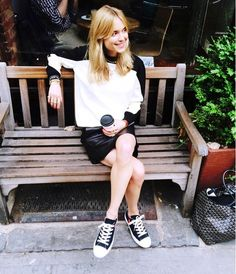 Pernille makes black and white look effortlessly chic in pairing a black leather skirt with casual kicks. // #Fashion