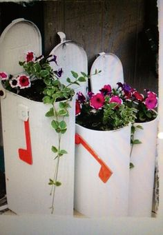 Repurposed mailboxes into planters