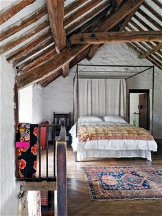 Love the white-washed walls and exposed beam.