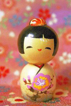 smiling kokeshi