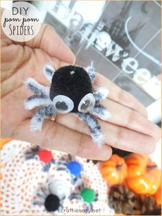DIY Pom Pom Spiders - craftionary.net #Halloween