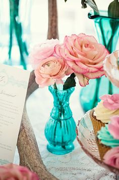 Lovely pink flowers and vintage turquoise vases as table centerpieces #wedding #turquoise #turquoisewedding #weddingdecor #receptioncenterpiece