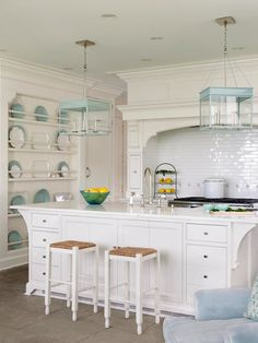 Love the #clean #crisp look of this #kitchen...white with pops of #color