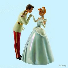 """Enesco 2010  Walt Disney Classic Colleciton  Royal Introduction  Commemorating the 60th Anniversary of Walt Disney's animated classic, Cinderella, this numbered limited edition sculpture is plussed with pearl earrings, opalescent an metallic paint accents.    Materials: Earthenware  Size: 9""""H x 6.5""""W x 5.5""""L"""