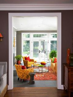 i like the wood/slate flooring...and the clean lines of the bright entry...    Analogous Color Scheme: Goldenrod + Kumquat