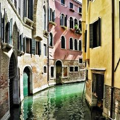 Vibrant Venezia: The late morning sun warms the flower adorned windows of this colorful Venetian canal. #travel #italy #venice