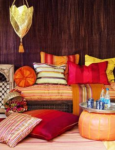 moroccan decor accessories in orange and red colors and forged metal lanterns