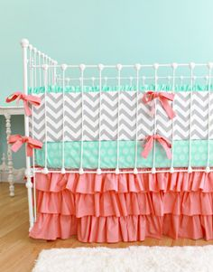 Mint and coral nursery - so pretty, love the colors!