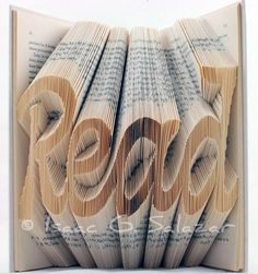 isaac salazar takes old books and folds and cuts into pages to create words and images