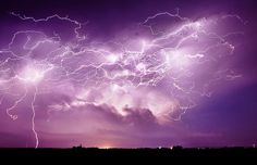 Lightning from a supercell thunderstorm in Central City, Nebraska. by Jason Weingart