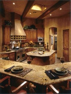 16 Amazing Classic Kitchens to get inspired from! This is perfect... exactly what i want in a kitchen... space to move around with no walls seperating the rooms, and a kitchen wrap-around hightop for people to eat at