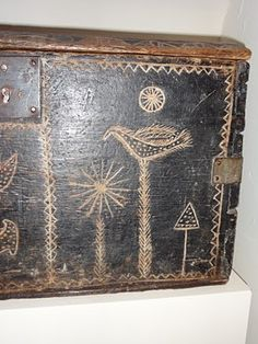 Wooden box with carved designs.