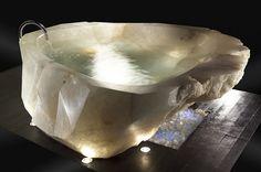 A bath tub cut out of a large single piece of Quartz Crystal.  COOOOOOOOL!