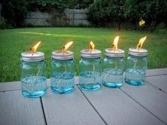 Mason jars, some cotton string and some liquid citronella - let the string soak for 10-15 min before lighting it up