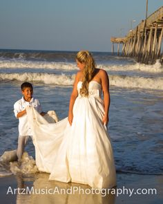Ring Bearer helps The Bride keep her dress from getting wet.  Nags Head, NC