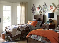 boys bedroom.  Love the baseball cards above the beds.