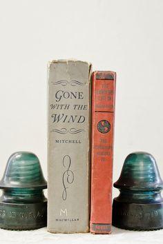 Antique glass insulators as book holders.