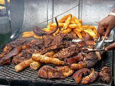 Jamaican jerk pork festival (fried slightly sweet dough that's eaten ...