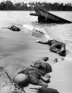 This photo, in which three American soldiers lie dead in the sand on Buna Beach in New Guinea, was taken in February 1943, but was not published until September. It was the first time an image of dead American troops appeared in LIFE during World War II without the bodies being draped, in coffins, or otherwise covered up. George Strock's Buna Beach photo