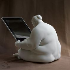 iPad docking station that combines art with tech. Gorgeous.
