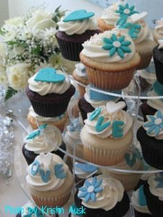 wedding cupcakes with blue flowers