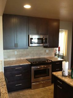 espresso cabinets and subway tile