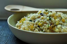 Summer Squash Couscous w/ Sultanas, Pistachios, Mint  Serves 4  1 tblsn lemon zest  Juice of one lemon  1/2 teaspoon honey  Olive oil  3 garlic cloves, crushed  1 1/4 cup veggie stock  1 cup couscous  1/2 cup diced yellow squash  1/2 cup diced zucchini  1 medium shallot, finely chopped  1/2 cup sultanas/golden raisins  1/4 cup chopped pistachios  Kosher salt  2 tablespoons chopped fresh mint  Freshly ground black pepper