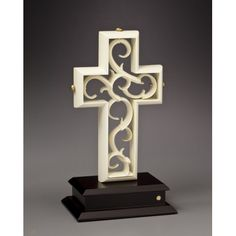The Unity Cross® is a multi-piece sculpture that is assembled by the bride and groom during the wedding ceremony, representing how the two become one. The two crosses are locked together by the three pegs that represent the Father, Son, and Holy Spirit.