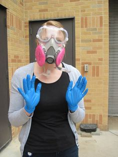 Film preservationist Kelly Kreft dons protective gear before opening a canister suspected of containing nitrate film. Learn more about the Missouri History Museum's work to preserve the historical films in its archives: http://historyhappenshere.org/archives/7320#.