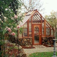 beautiful green house!! love the rocks!