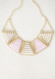 """Geometric Pearls Necklace 22.99 at shopruche.com. Polished with a luminescent glow, this elegant gold toned bib necklace features an adjustable chain, glowing faux pearls, and faceted pink beads.13"""" long, Pendant: 8"""" long, 1.75"""" wide"""