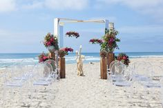 A structure gives you hanging capabilities but doesn't block a gorgeous beach view!  Design by Alchemy Fine Events