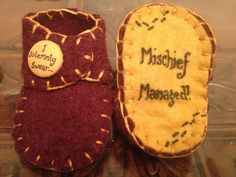 Harry Potter Gryffindor 'I solemnly swear' 'Mischief Managed' red yellow baby booties newborn to 3 months - handmade wool felt with buttons. $15.58, via Etsy.
