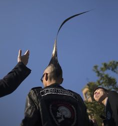 """Japanese fashion designer Kazuhiro Watanabe, who holds the world record for the """"Tallest Mohawk,"""" is photographed from behind at a media event in New York"""