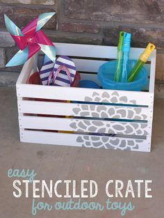 This DIY stenciled crate is perfect for summer organizing from www.sisterssuitcaseblog.com