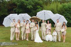 Rainy day wedding party photos with umbrellas!