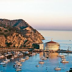 Santa Catalina Island, California. Every American who has fantasized about living on a Mediterranean island can relax. There's a place much closer to home where you can enjoy the mild climate without changing currency or learning another language: Santa Catalina Island. | Coastalliving.com