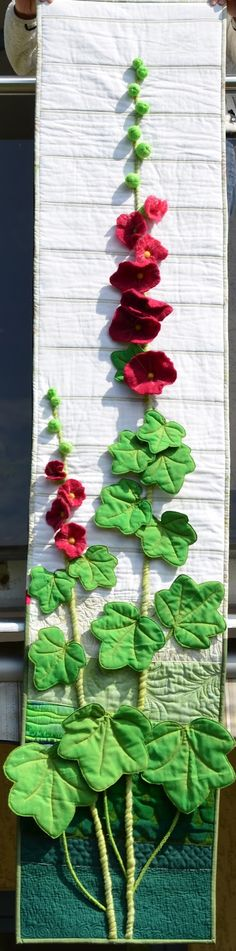 Holly Hock quilted wall hanging. Felted Flowers, leaves are appliqué.