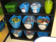 math center...i like the way she has the smaller green bins there on the top shelf for individual groups to take a few supplies at a time!