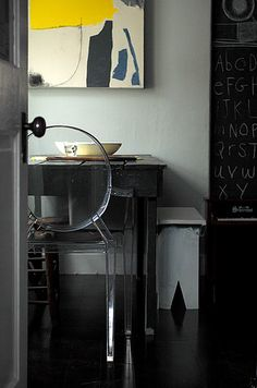 love the contrast of the rustic desk and the glam of the chair..