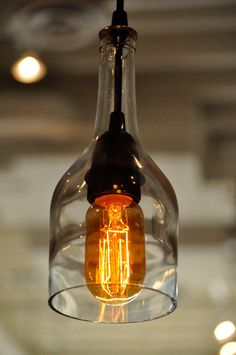 Recycled glass bottle hanging gin lamp pendant with Edison Lightbulb. Really great price too! Via Heirloom 2011.