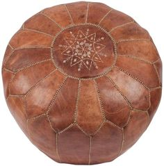 Natural Moroccan Pouffe:   I need you, I want you, Ooh baby, Ooh baby.  [For my next pay check]  The tan leather is dreamy.